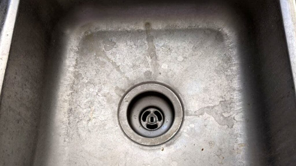 how to clean a stainless steel sink step 1 - empty the dirty sink